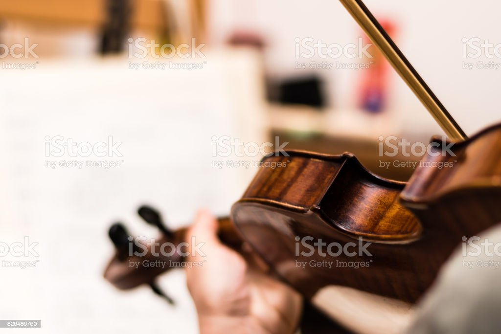Musician playing the brown violin stock photo