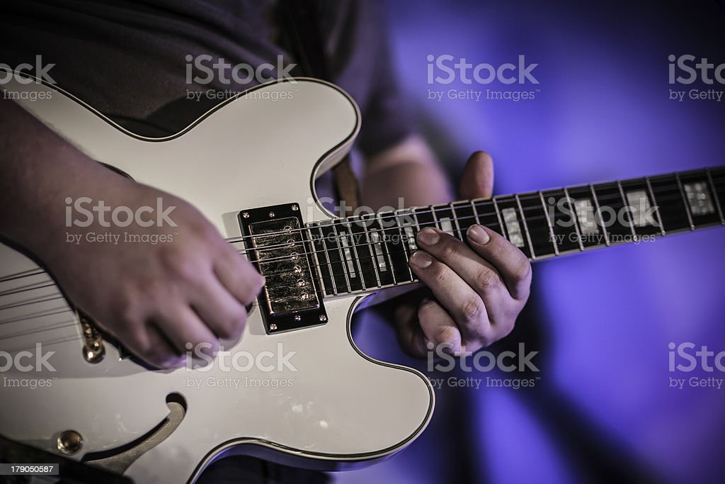 Musician playing the guitar in a club stock photo