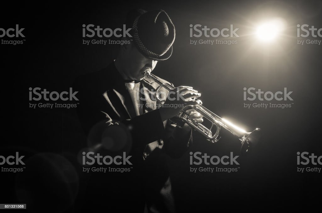 Musician playing the Trumpet with spot light on the stage stock photo