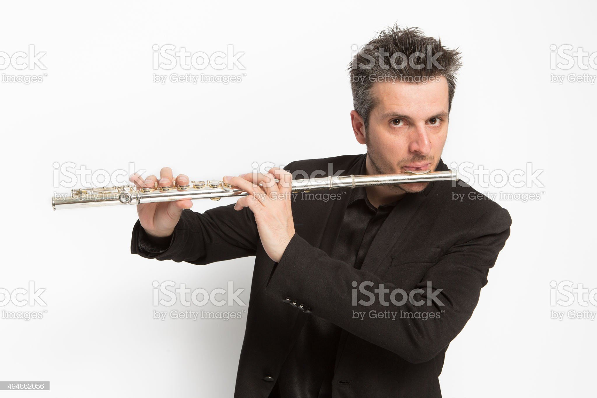 Musician playing transverse flute royalty-free stock photo