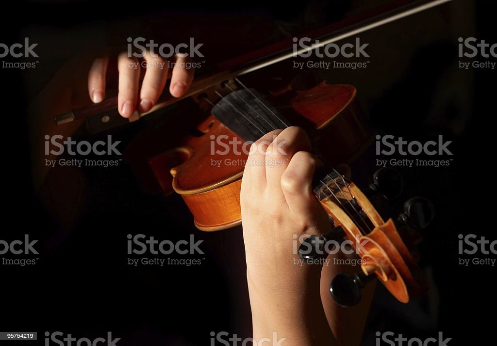 Musician playing violin isolated on black royalty-free stock photo