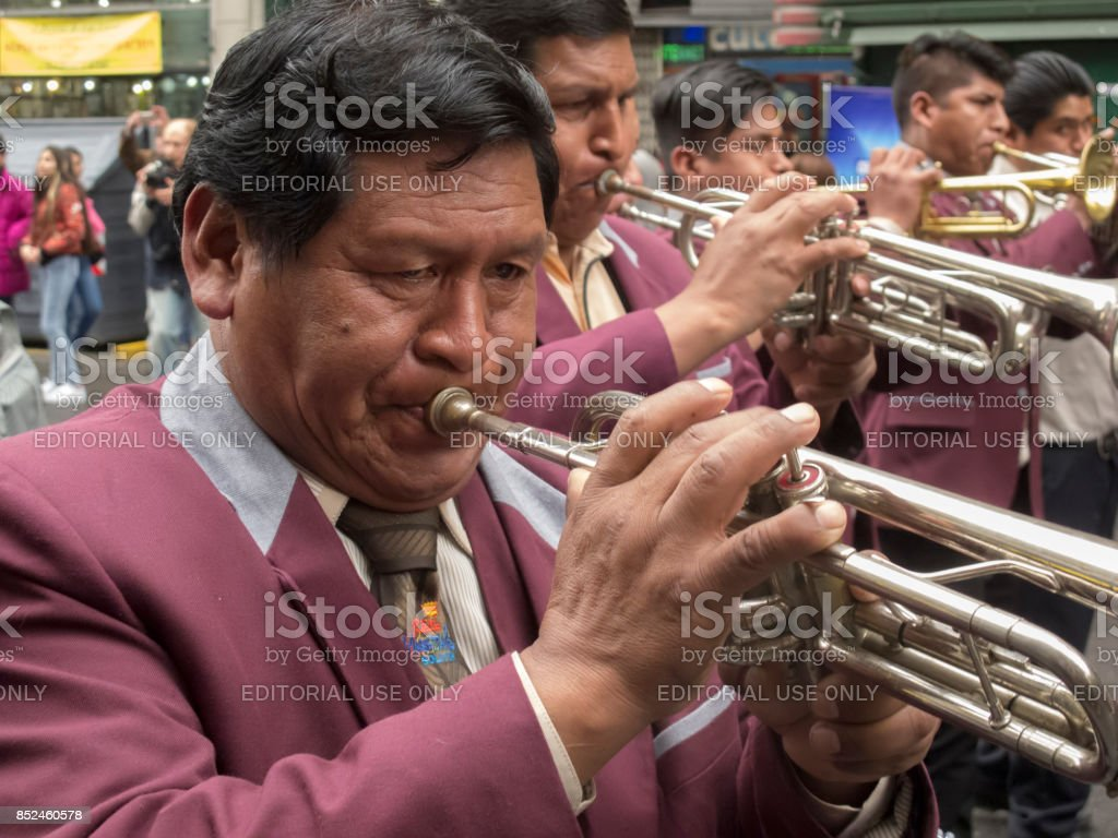 Musician playing with his band at a traditional bolivian parade that takes place annually in Buenos Aires dowtown stock photo