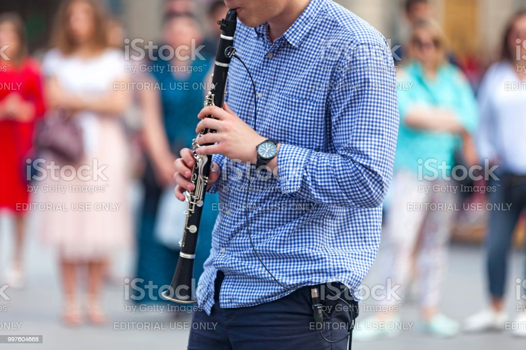 Musician playing with his electric clarinet stock photo