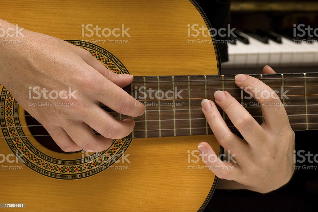 musician plays a guitar royalty-free stock photo