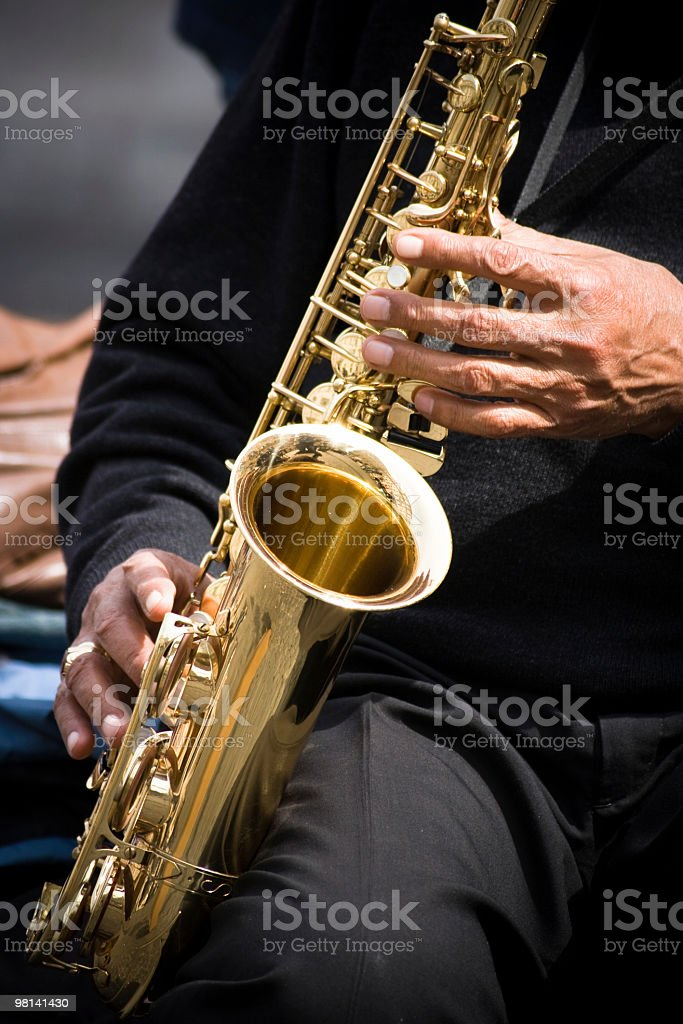 Musician Plays Saxophone Shiny Gold royalty-free stock photo
