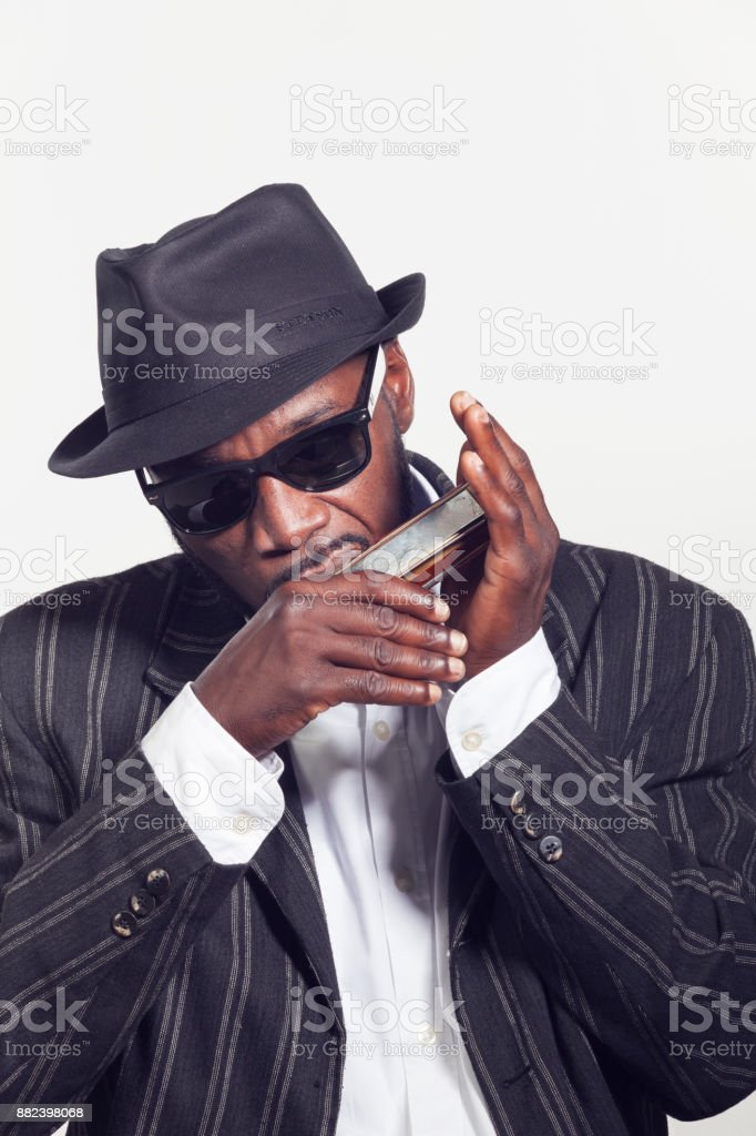 musician plays the harmonica stock photo
