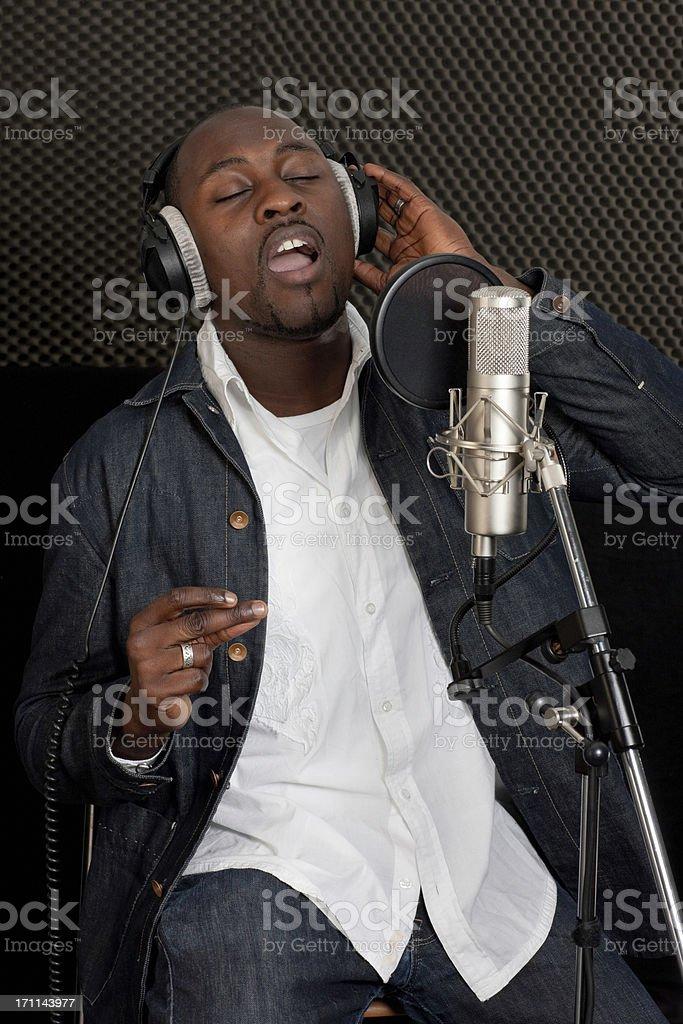 musician singer in recording studio stock photo