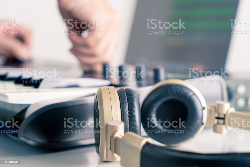 Musician sound engineer is working in home music studio synthesizer stock photo