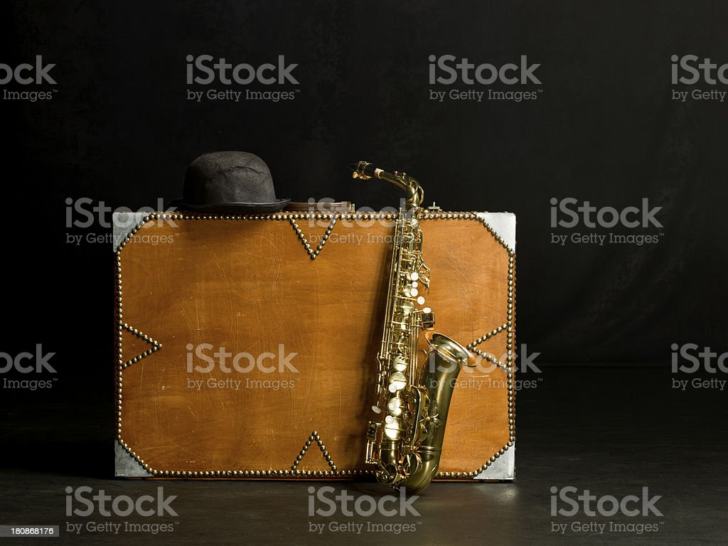 Musician suitcase and Saxophone royalty-free stock photo