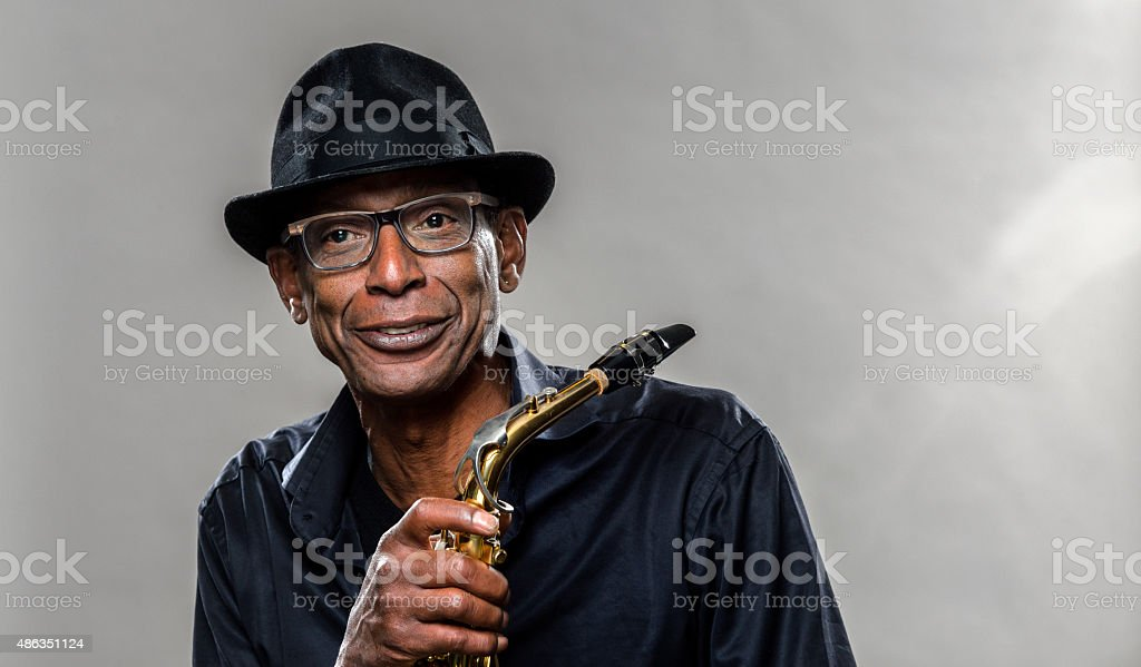 Musician with saxophone and big smile stock photo