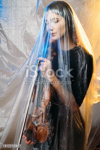 istock musician woman defocused art portrait psychology 1312212317