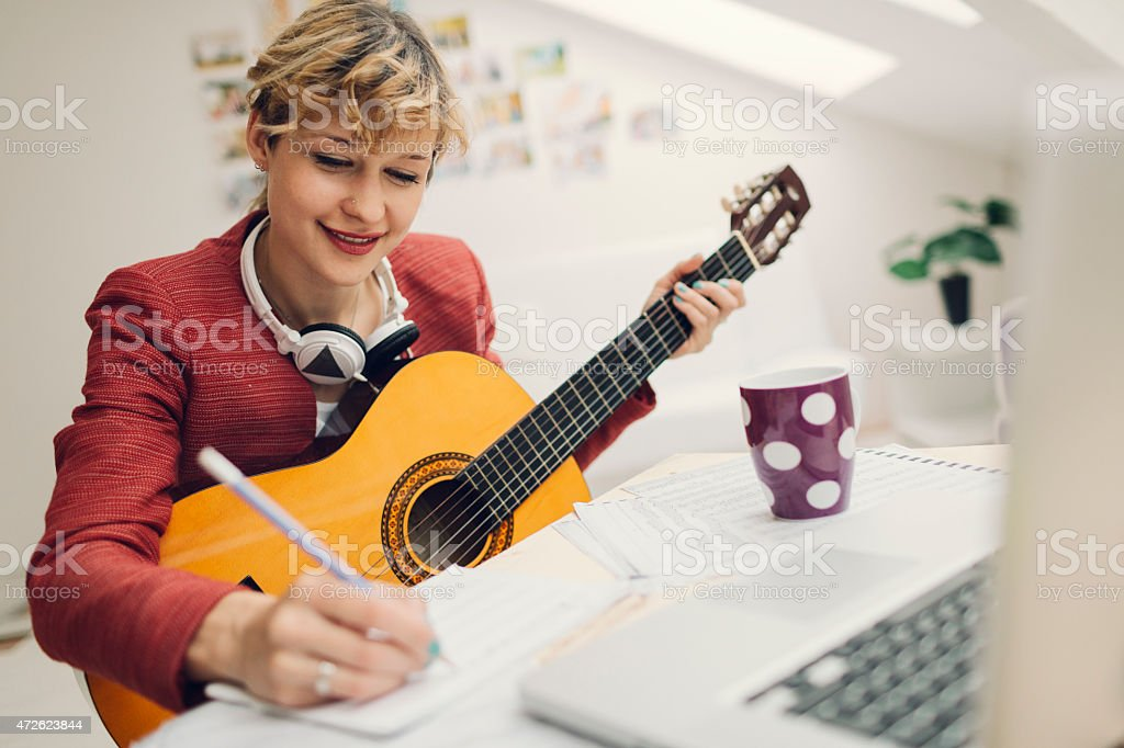 Musician Writing Song. stock photo