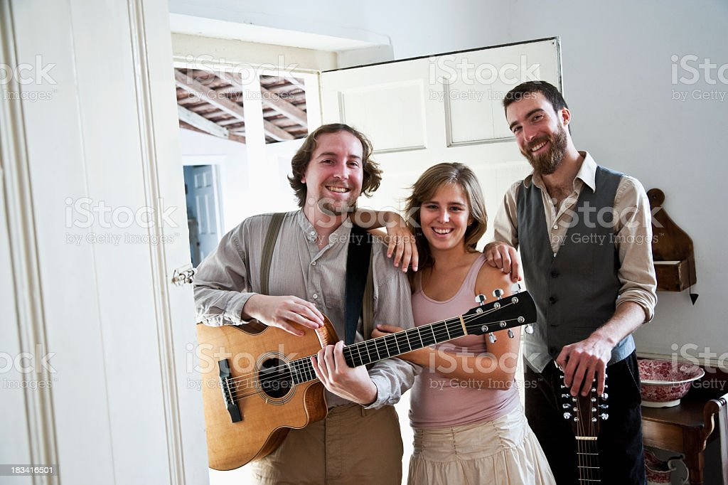 Musicians and friends hanging out royalty-free stock photo
