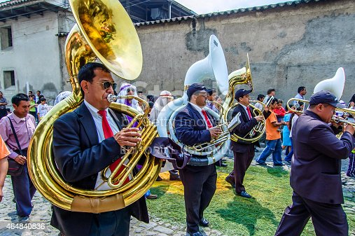 Antigua, Guatemala -  April 1, 2012: Musicians at rear of Palm Sunday procession in Spanish colonial town & UNESCO World Heritage Site with most famous Holy Week celebrations in Latin America.