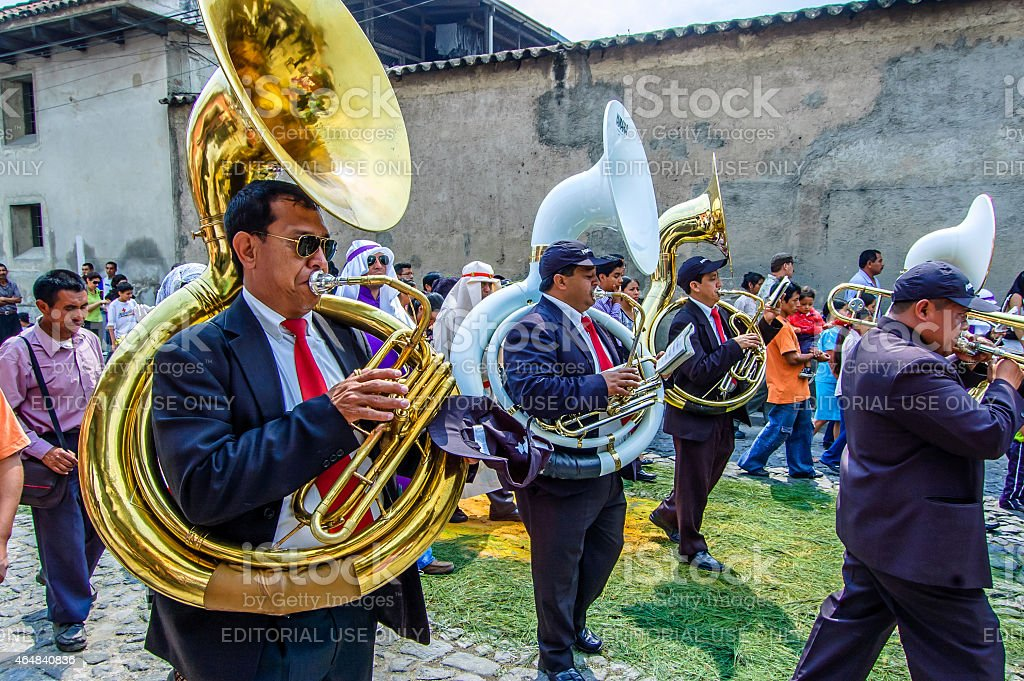 Musicians at rear of Palm Sunday procession, Antigua, Guatemala stock photo