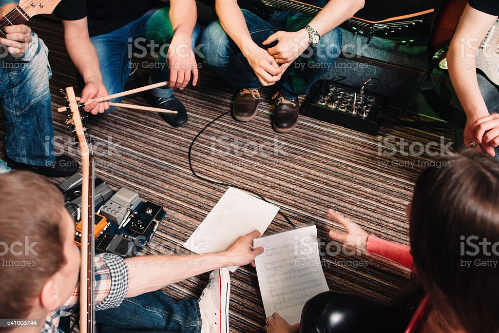 Musicians discussing new song top view stock photo