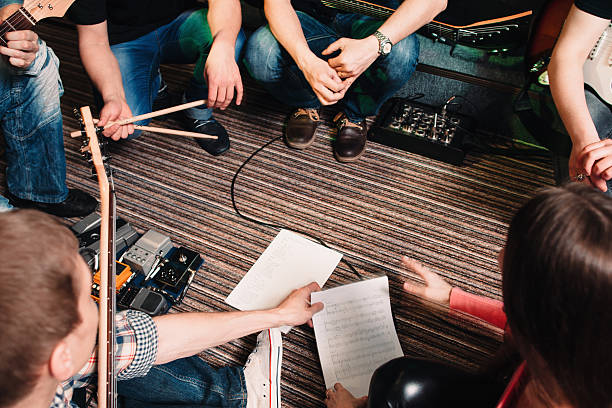 Musicians discussing new song top view stok fotoğrafı