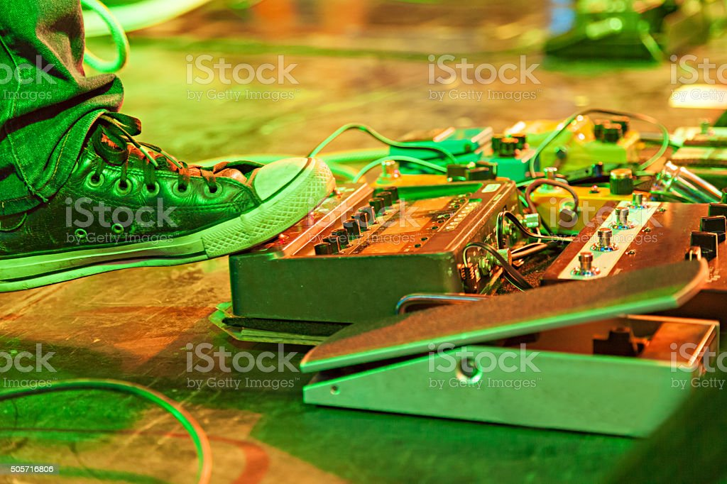 Musicians feet on stage at concert stock photo