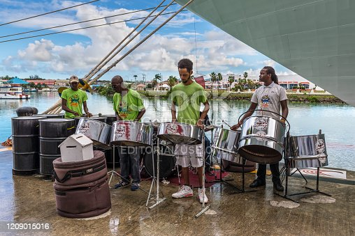 St John's, Antigua and Barbuda - December 18, 2018: Musicians greets visitors at the cruise port of the seaside town of St John's, Antigua and Barbuda.