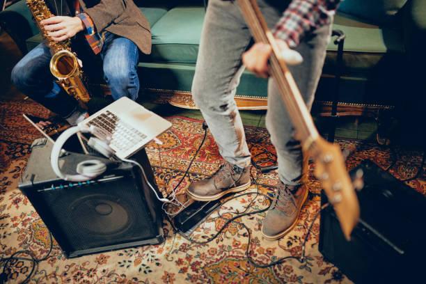 Musicians having rehearsal in home studio. stock photo