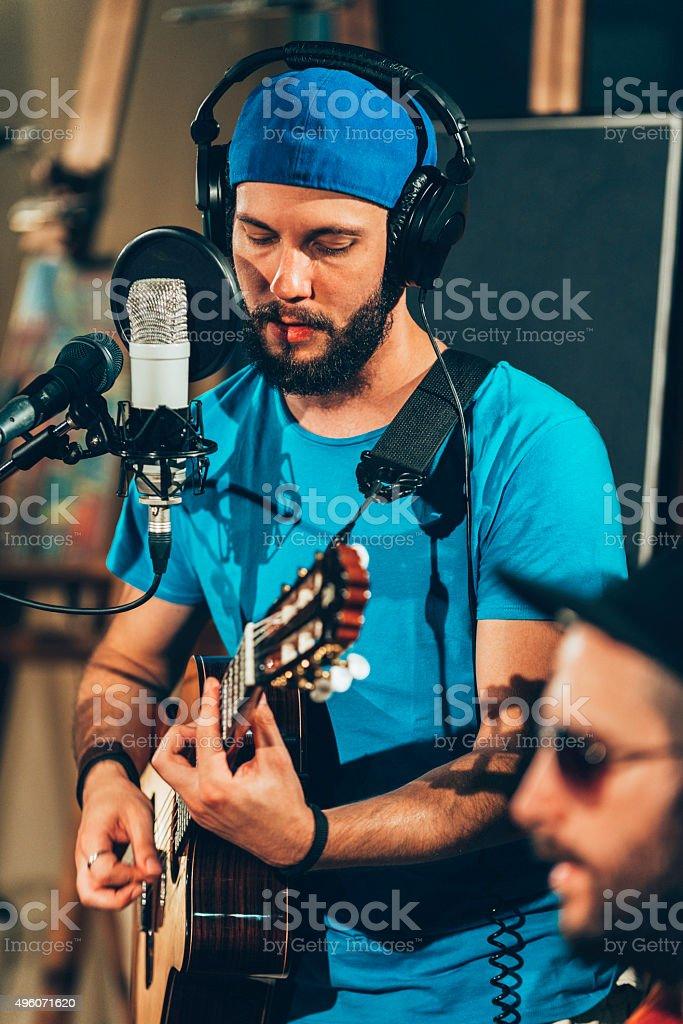 Musicians in recording studio stock photo