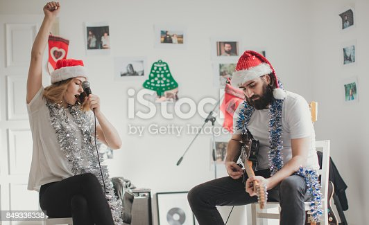 849362192 istock photo Musicians making a christmas song 849336338