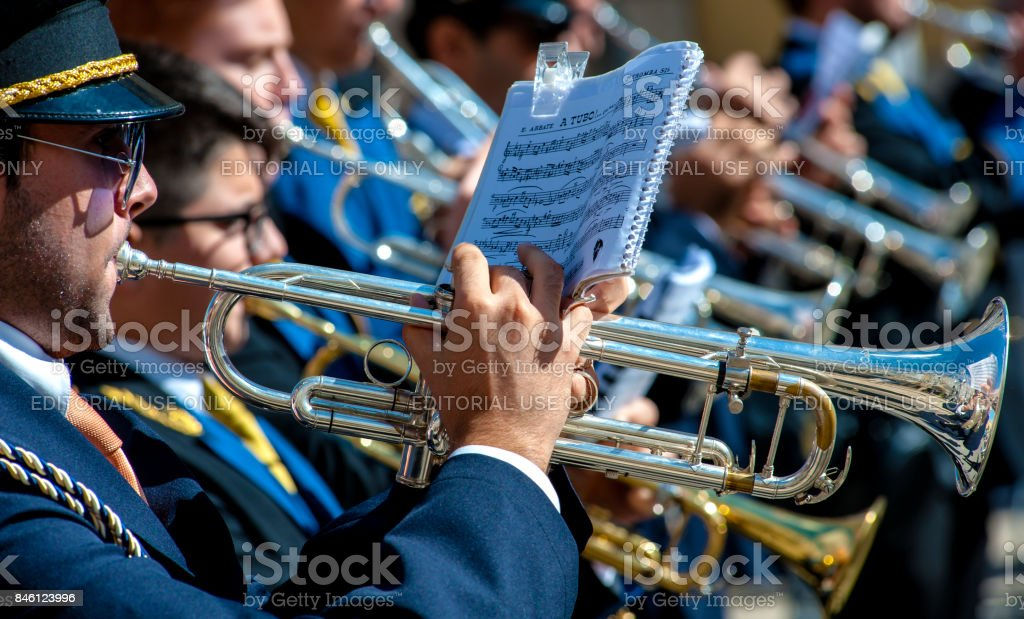 Musicians perform pieces of church music in street stock photo