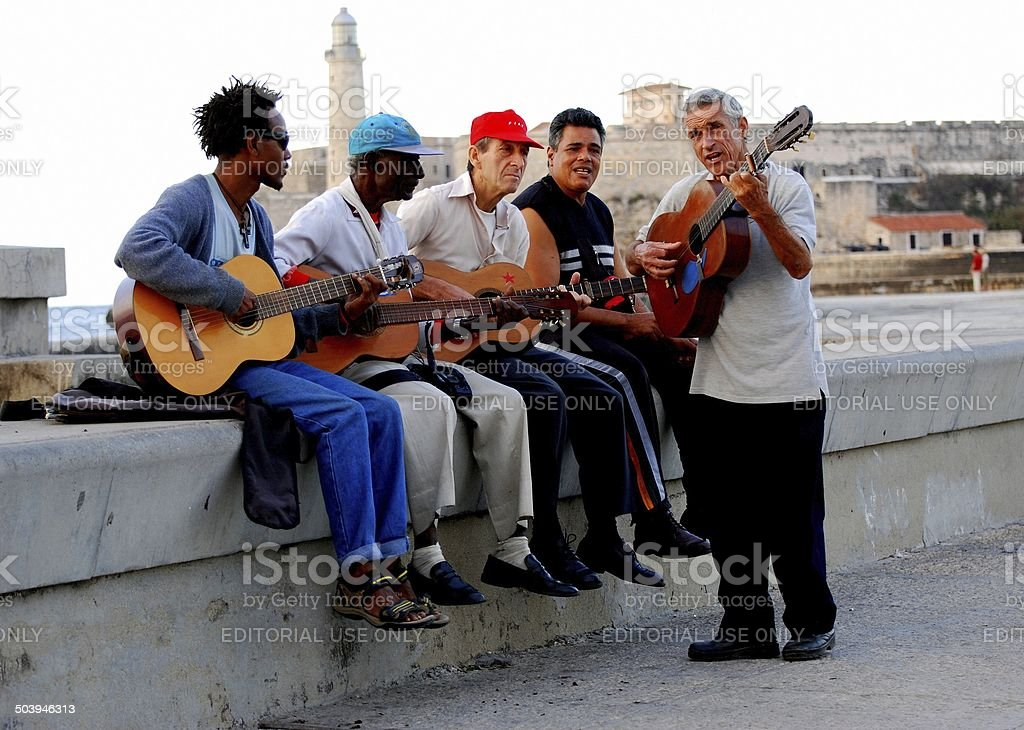 Musicians play instruments and sing on Havana's Malecon stock photo