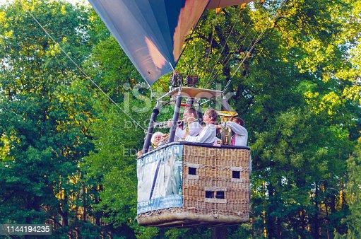Belaya Tserkov, Ukraine, August 23, 2018: musicians play wind instruments in a hot air balloon basket