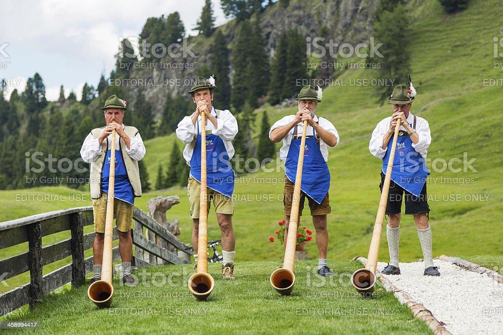 Musicians Playing Alphorn stock photo