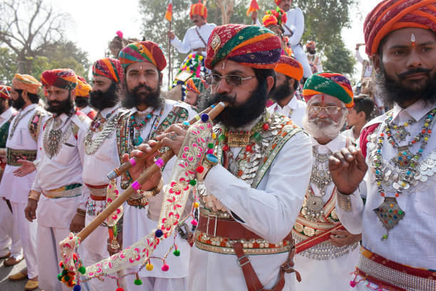Musicians playing during Camel festival in Bikaner, Rajasthan, India stock photo