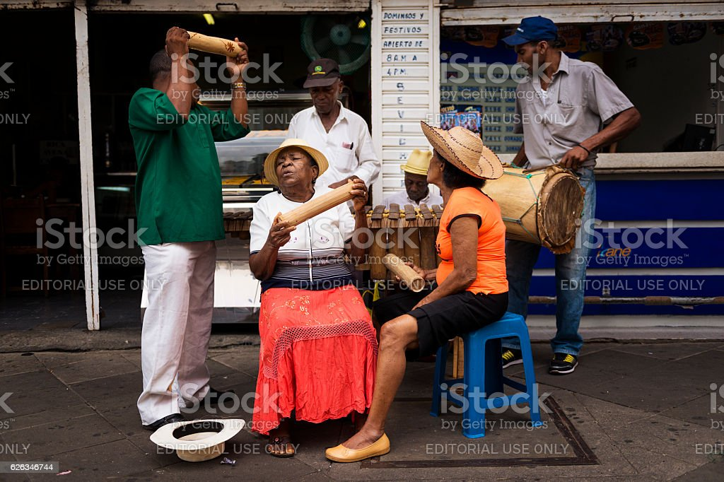 Musicians playing in a street of Cali, in Colombia stock photo