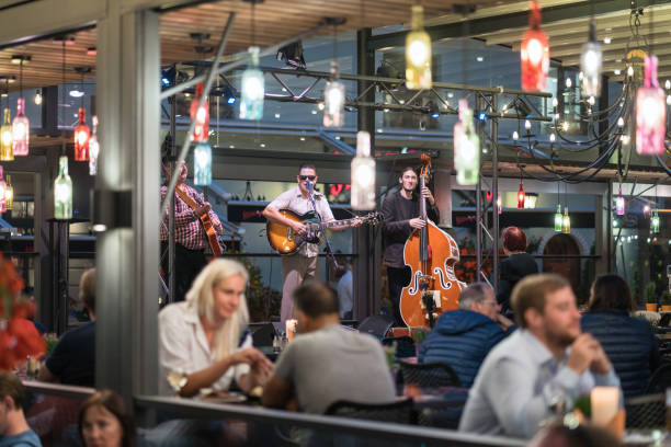 Musicians playing in an outdoor cafe. stock photo