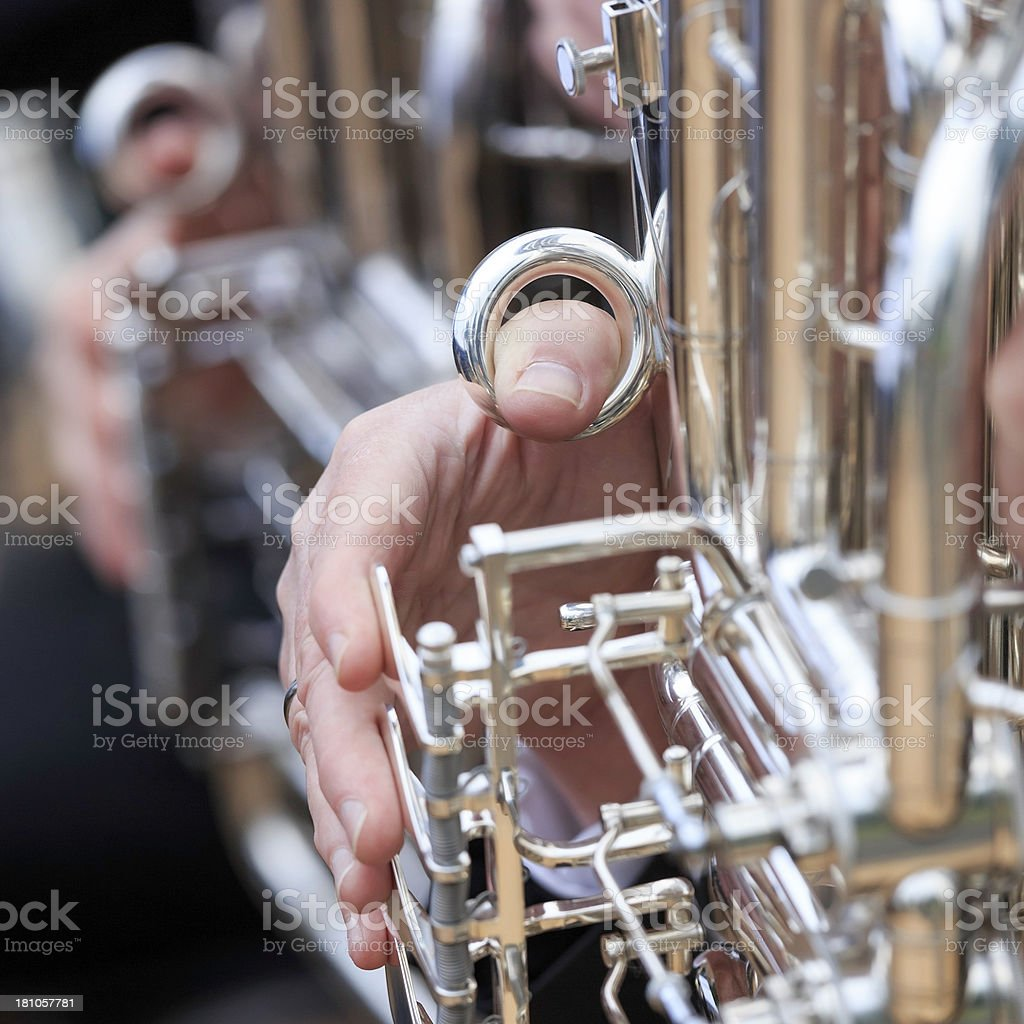 Musicians playing tuba's in orchestra at outdoor concert, square close-up royalty-free stock photo