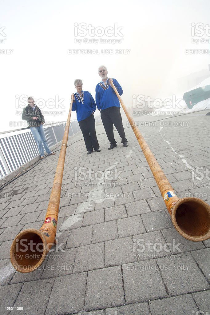 musicians with Alpine horns royalty-free stock photo