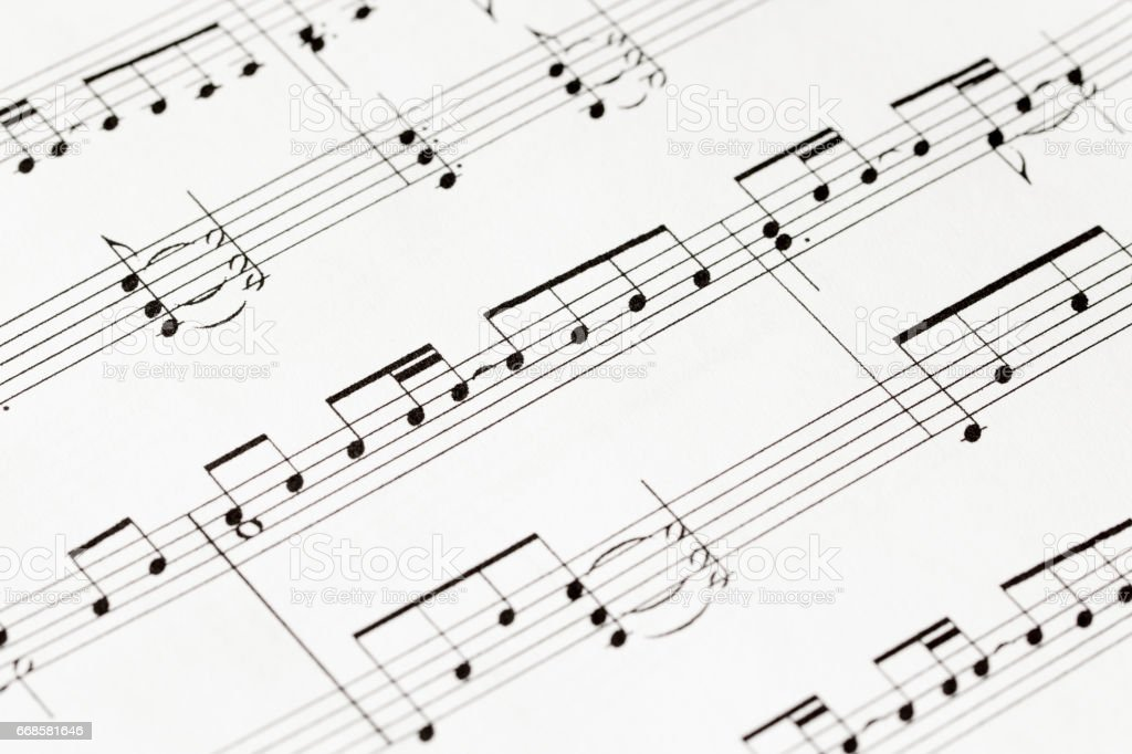 music-notes on white paper macro stock photo