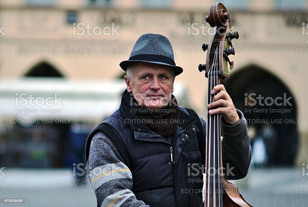 Musikant playing bass at Old Town Square stock photo