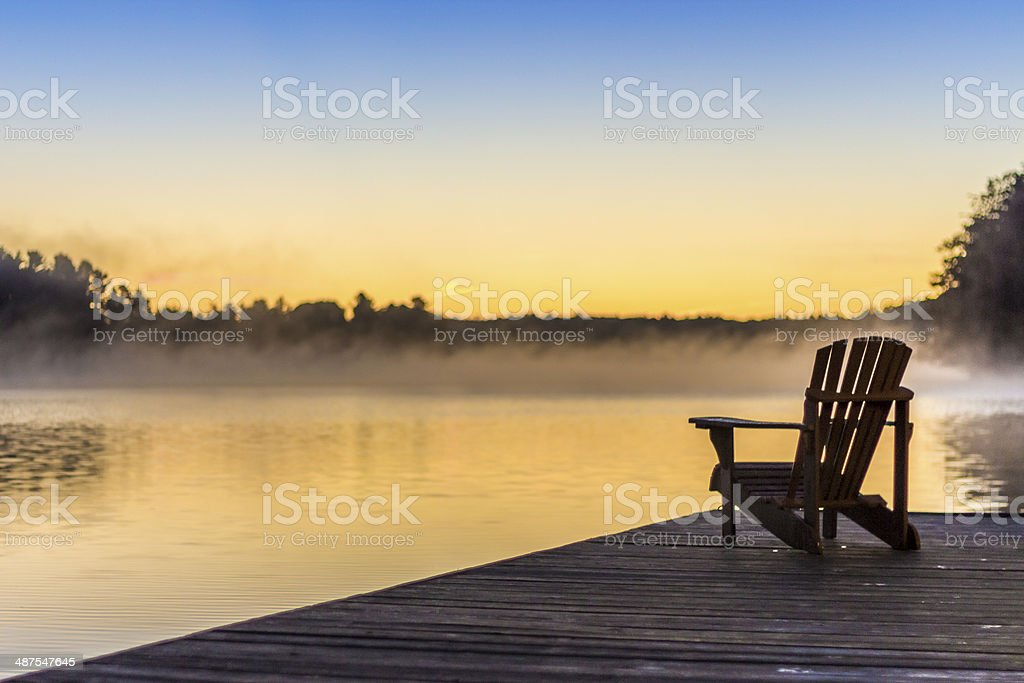 Muskoka Chair on Dock stock photo