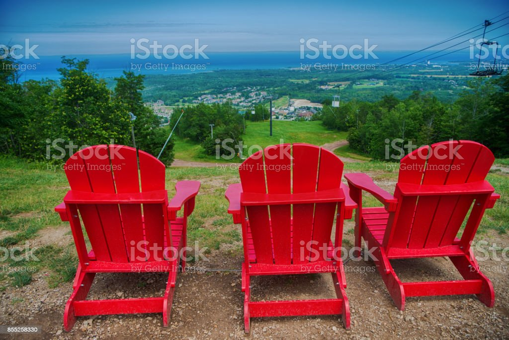 Muskoka chairs at Blue Mountain resort and village in Collingwood, Ontario stock photo