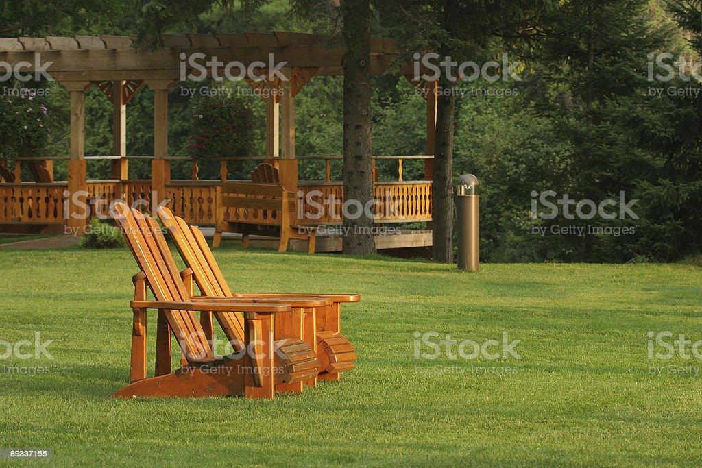 Muskoka chairs on a beautiful lawn royalty-free stock photo