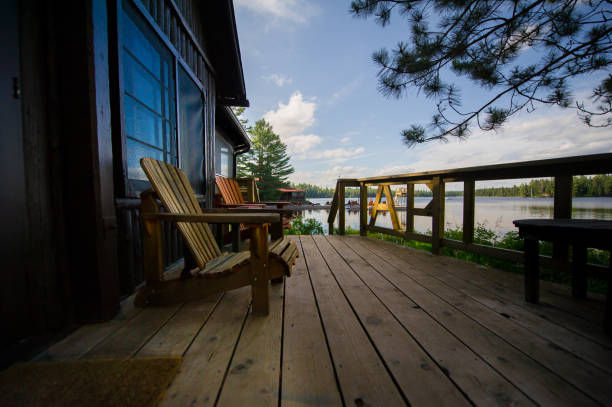 Muskoka chairs on a wooden deck stock photo