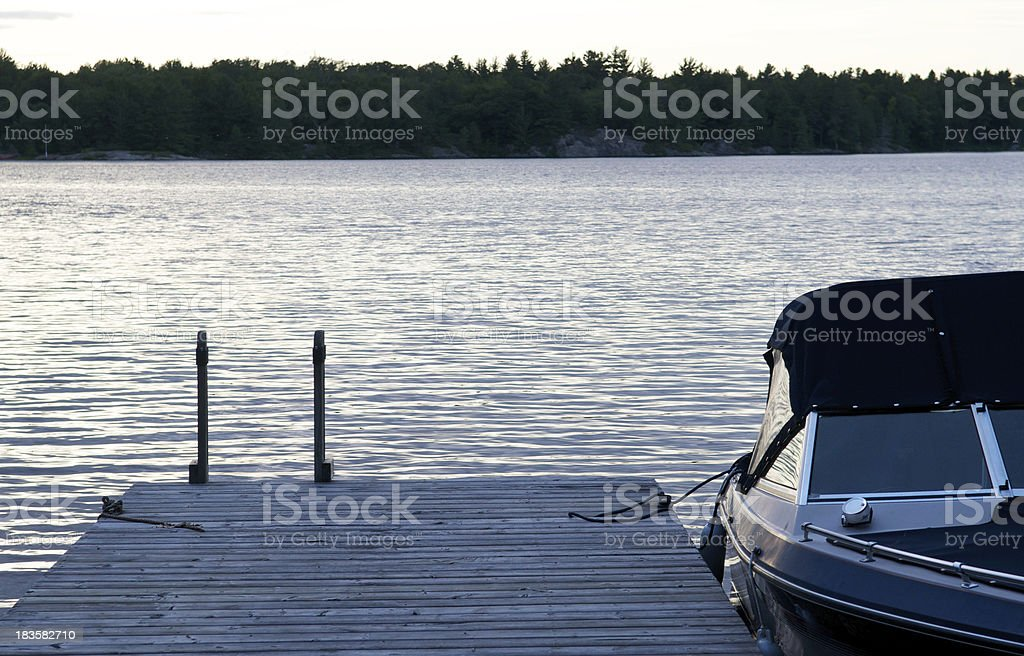 Muskoka Ontario Cottage Dock and Boat royalty-free stock photo