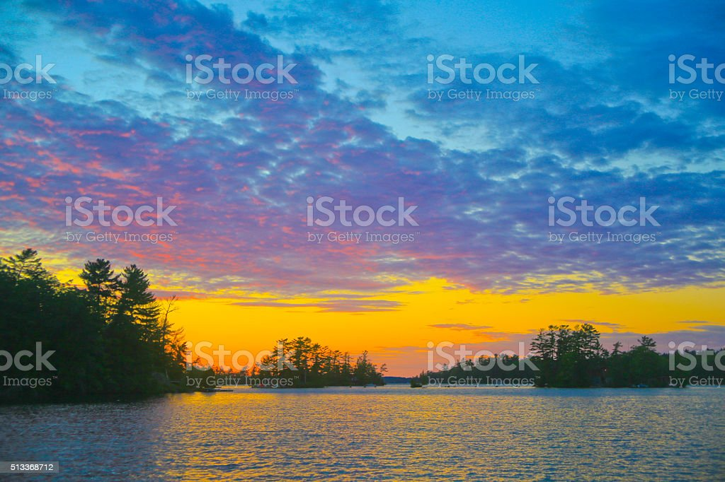 Muskoka Sunset with Red Reflections on the Clouds stock photo