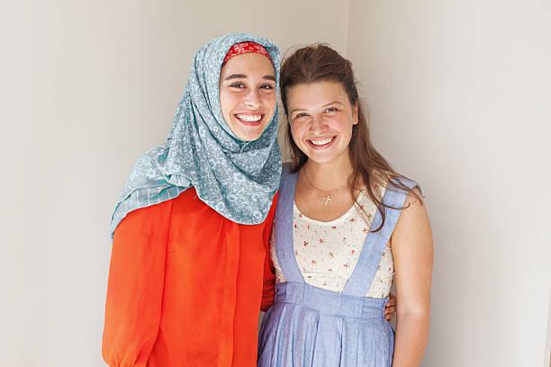 muslim and christian girl together stok fotoğrafı