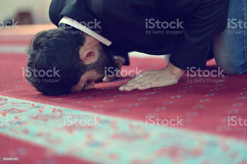 Muslim Arabic man praying stock photo