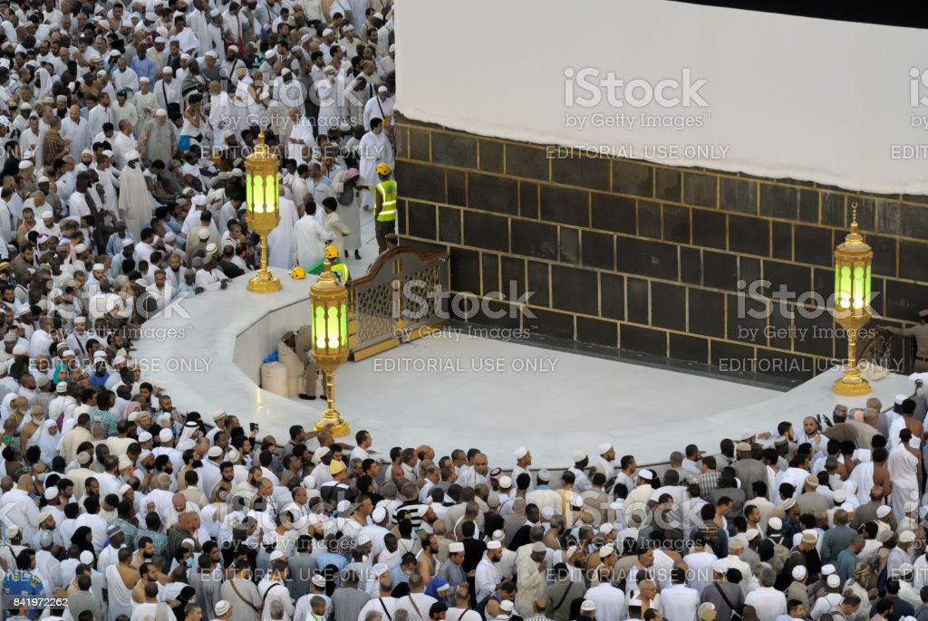 Muslim believers at hicr ismail next to Kaaba in Mecca stock photo