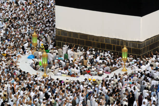 Muslim believers at hicr ismail next to Kaaba in Mecca Mecca, Saudi Arabia - September 9, 2016: Muslim pilgrims put on their white ihrams praying in hijr ismail next to the holy Kaaba during Hajj in Saudi Arabia circumambulation stock pictures, royalty-free photos & images