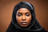 Muslim beautiful black woman wearing a hijab looking at the camera