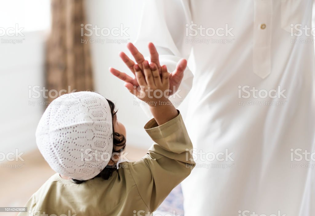 Muslim boy giving a high five stock photo