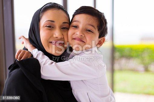 istock muslim boy hugging his mother 513384360